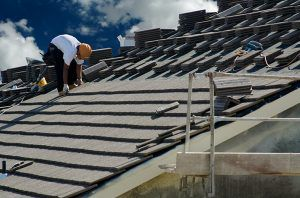 Man Preparing Roof To Install