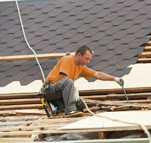 Man Repairing Roof Orange